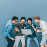 Group Of Asian and Multiethnic Business people with casual suit using each technology equipment with happy and celebrate action at the outdoor over the wall background, people business group concept